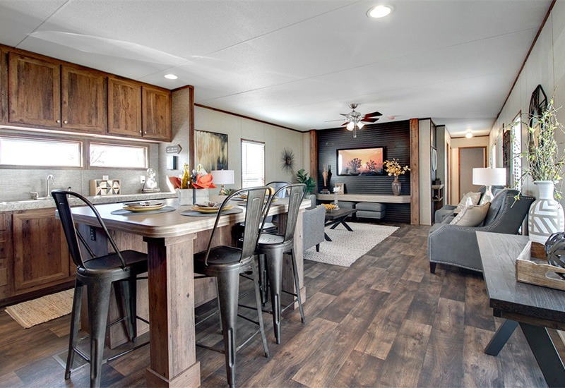 The Revolution REV16763A Mobile Home Kitchen and Dining Area and Living Room