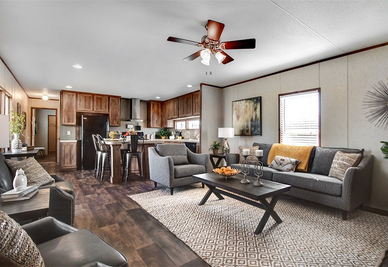 The Revolution REV16763A Mobile Home Living Room and Dining Area and Kitchen
